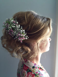 Formal spring up-do with flower pin.