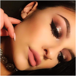 formal makeup look with winged eyeliner