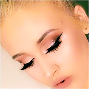 formal makeup look with winged eyeliner and smoky eye
