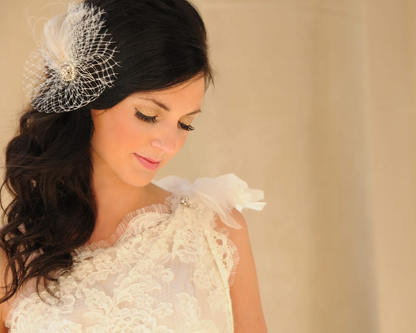 bride with hair styled to the side with decorative clip