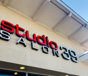 store front of Studio 39 Salon in red and gray letters